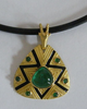 emerald and 18 carat gold pendant